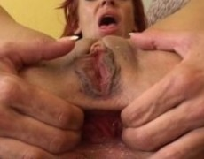 Shannon inserting a long brutal arse sex toy